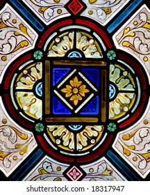 Pretty pattern in a stained glass window - a church in Cornwall, England.