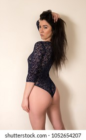 Pretty petite brunette in a black lace bodysuit