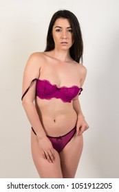Pretty petite brunette in purple lingerie