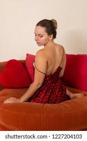 Pretty petite brunette in a red and black dress