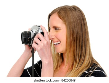 Pretty photographer taking photos in studio, isolated on white