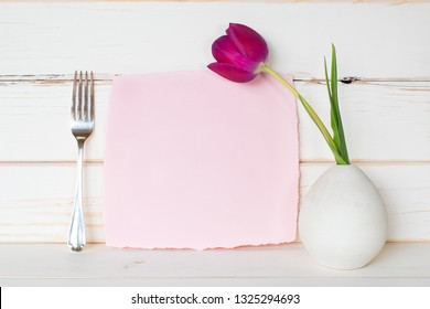 Pretty Pink Card with Purple Tulip Flower in Modern Vase with Fork against white Shiplap board wall and table.  Horizontal with side view