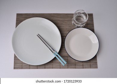 Pretty plate and fork and knife for the pleasure of cooking