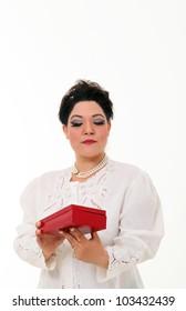 Pretty plus size woman opening a box gift