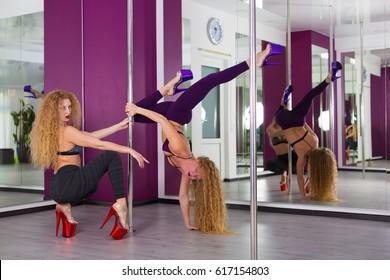 Pretty pole dancer training in the studio
