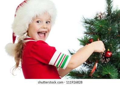 pretty preschool child decorating Christmas tree isolated on white