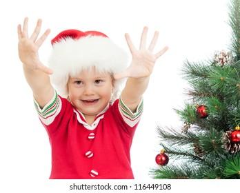 pretty preschool child near Christmas tree isolated on white