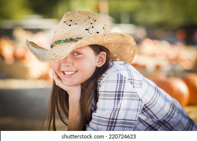 Pretty Preteen Girl Wearing Cowboy Hat Portrait at the Pumpkin Patch in a  Rustic Setting. 06a9e7334ec5