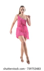 Pretty professional woman dancing cha cha in pink costume. Full body length portrait isolated on white studio background.