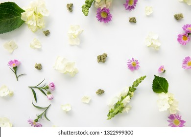 Pretty Purple Daisy Spring Flowers Floral Cannabis Background Wallpaper with Marijuana Nugs or Buds - Top Down Close Up
