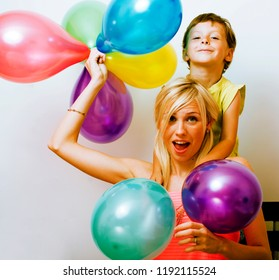 pretty real family with color balloons on white background, blon