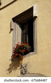 Pretty red flowers decorate a house in  Regensvurg, Germany
