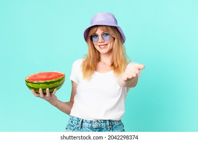 pretty red head woman and holding a water melon. summer concept