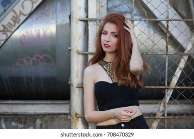 pretty redhead girl relaxing outdoors