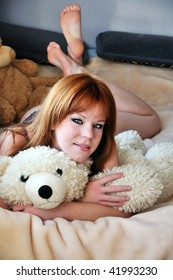 pretty redheaded girl laying on the bed