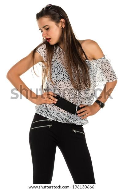 Pretty Romanian brunette in a polka dot blouse