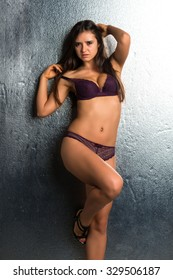 Pretty Romanian brunette in purple lingerie