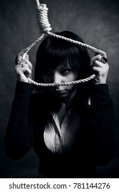 pretty sad gothic girl with loop posing over dark