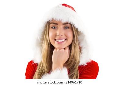Pretty santa girl smiling at camera on white background