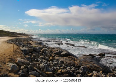 Pretty scenic view of the rocky coastline with the cold Southern Ocean lapping the shore at remote isolated  Augusta, South Western Australia on a sunny day in mid winter.