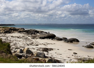 Pretty scenic view of the rocky  coastline with the cold  Southern Ocean lapping the shore at remote isolated  Flinder's Bay, Augusta, South Western Australia on a cloudy day in late spring.
