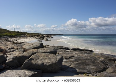 Pretty scenic view of the rocky coastline with the waves of the cold  Southern Ocean rolling in at remote isolated  Flinder's Bay, Augusta, South Western Australia on a fine cloudy day in late spring.