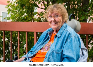 Pretty senior handicap woman outdoor portrait.
