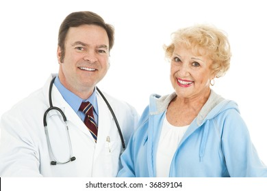 Pretty senior woman with her friendly, caring doctor.  Isolated on white.