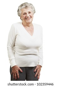 pretty senior woman smiling against a white background