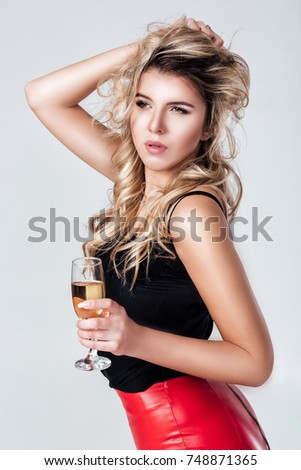 0024fca74dcf pretty sexy blond woman holding a glass of champagne and a bottle