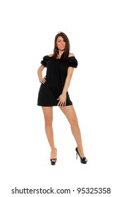 Pretty sexy girl full length posing in a nice black dress isolated over white background