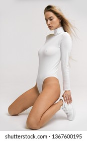 Pretty sexy girl posing in bodysuit with very fashion style, good for advertise and kind of sport goods