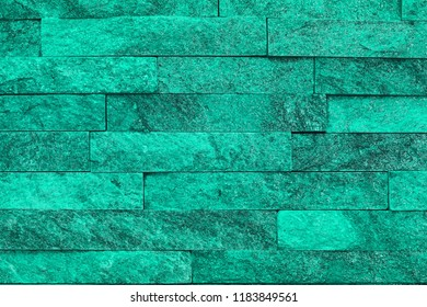 pretty shabby teal, sea-green natural quartzite stone bricks texture for use as background.