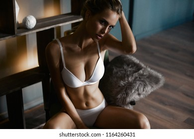 Pretty skinny young girl in perfect underwear posing with natural mood