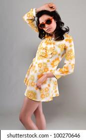 Pretty slender brunette in a vintage sixties miniskirt