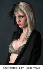 Pretty slender woman in a two tone wig and chain mail bikini