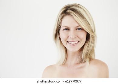 Pretty smile on beautiful blond woman, studio