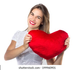 Pretty smiling girl with a red heart