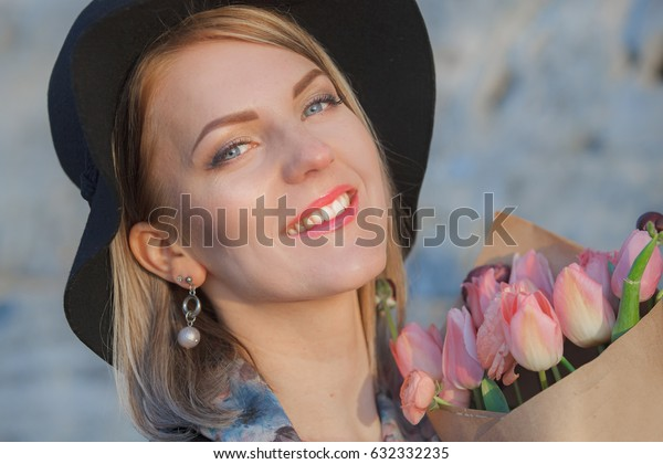 Pretty smiling  girl with tulips