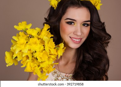 Pretty smiling girl with yellow flowers