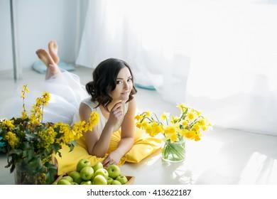 Pretty smiling girl yellow flowers lying stock photo download now pretty smiling girl with yellow flowers lying on floor studio indoor portrait mightylinksfo