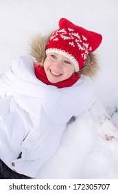 Pretty smiling little girl in wintertime.