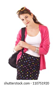 Pretty smiling teenage girl in fashionable back to school clothes carries backpack over shoulder. Pink sweater, sunglasses on forehead, black short skirt. Vertical, isolated on white, copy space.