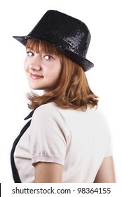 Pretty smiling woman in a black cap over white background