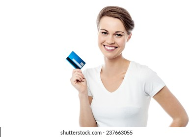 Pretty smiling woman holding up credit card