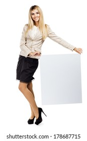 Pretty smiling woman holding a empty paper blank. Business woman