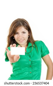 pretty smiling young woman or girl in green shirt with business card against white background. Copy space for text and marketing ideas and slogans