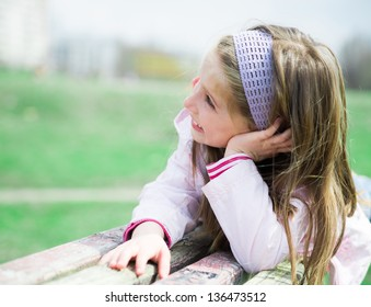 pretty smilling liitle girl in park