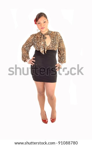 5235ffa3a A pretty south American woman in a short skirt and a brown blouse standing  with a rose in her hair and red heels for white background. - Image