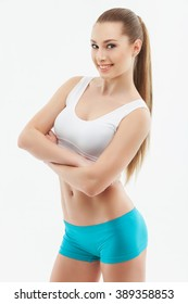 Pretty sporty girl is showing her perfect body